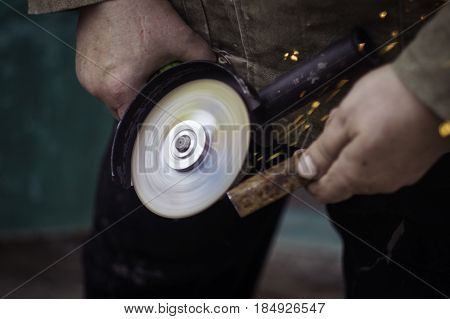 grinding machine in hand with sparcles diy at home