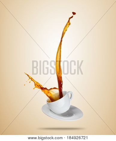 Porcelain white cup with splashing coffee or tea liquid separated on brown background. Hot drink with splash, beverages and refreshment. Copyspace for text.