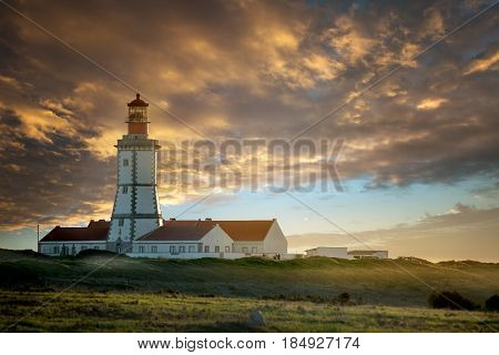 Beautiful Cabo Espichel lighthouse in Portugal by sunset