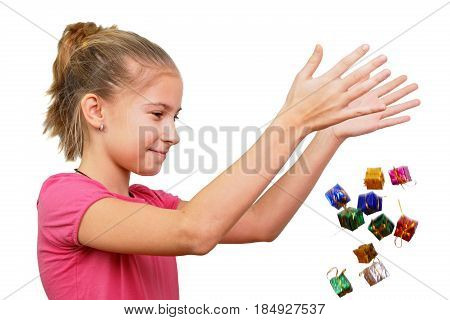 The girl throws miniature gifts conceptually isolated on white