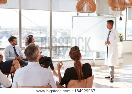 Doctor Making Presentation To Medical Staff In Hospital