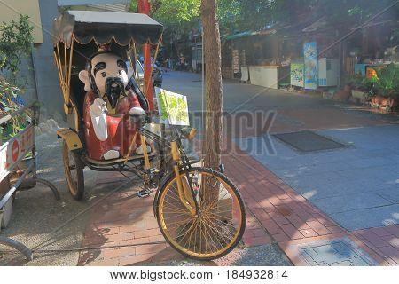 TAINAN TAIWAN - DECEMBER 13, 2016: Traditional rickshaw bicycle parked on street.