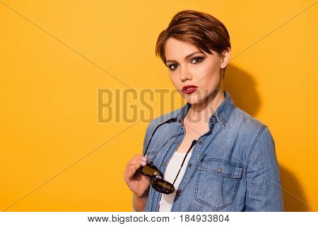 Stylish Look Of The Model With Fashionable Sunglasses And Casual Clothes On The Bright Yellow Backgr