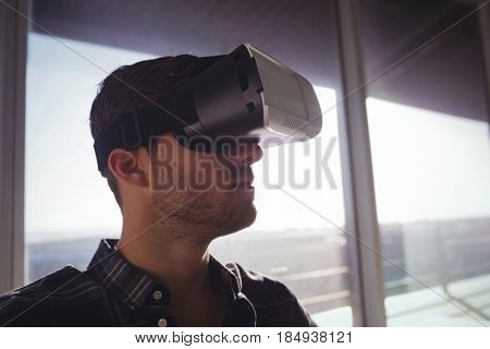 Businessman using virtual reality technology at office