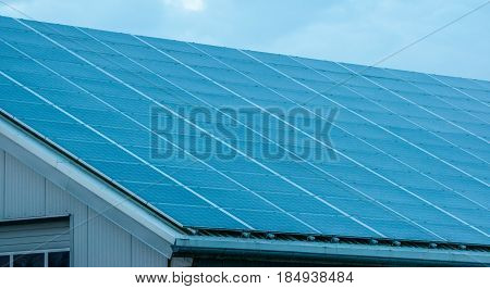 Solar Panels Against The Deep Blue Sky And Clouds