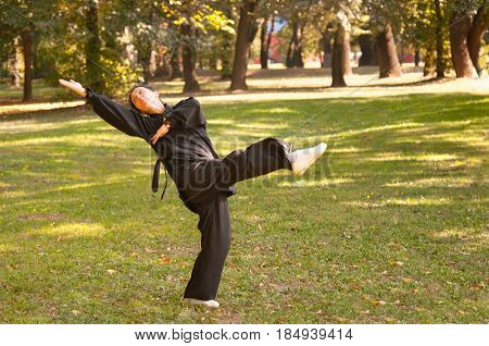 Martial Arts Training Outdoors. Green Background. Color Image