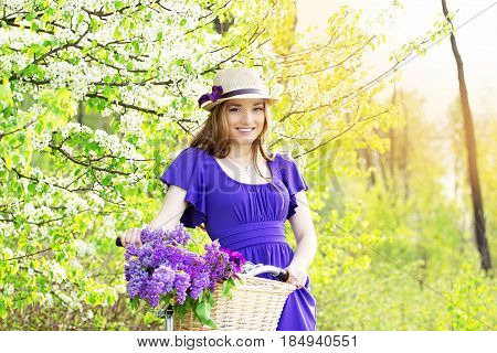 Portrait Of Young Beautiful Girl In Hat With Long Hair With Flowers In Basket On Vintage Bike. Fashi