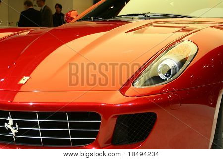 Part of a red sports car on display in a motor show. Editorial Use.