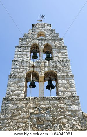 bell tower of very old stone church in areopolis in mani peninsula in greek peloponnese