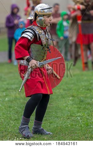 ALBA IULIA ROMANIA - APRIL 29 2017: Child dressed in Roman soldier make one demonstration at APULUM ROMAN FESTIVAL organized by the City Hall.