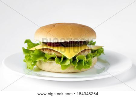 Cheeseburger On A Plate Isolated On White Background