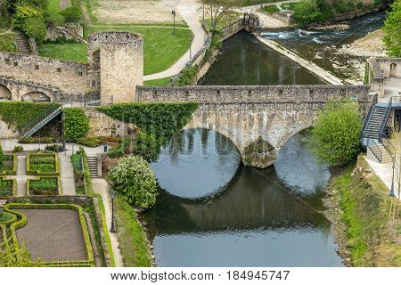 Old Medieval Bridge In Europe With Its Reflection On The Water. Casemates And Stone Bridge In Luxemb