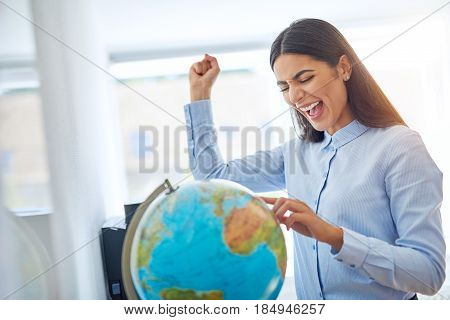 Jubilant Young Businesswoman Planning A Vacation