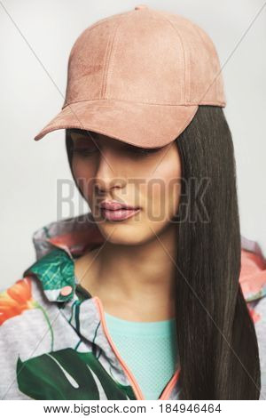 Woman In Pink Cap Portrait