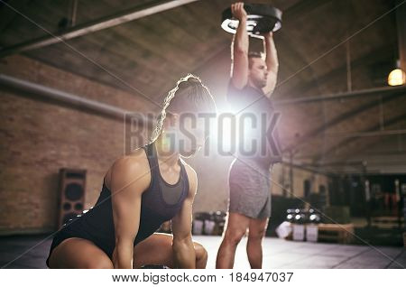 Two Strong Sportsmen Lifting Heavy Weight Discs
