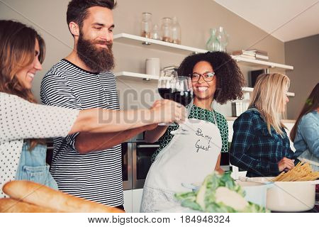 Best Friends Toasting With Wine In Kitchen
