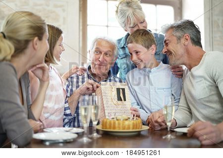 Family celebrating grandfather birthday together