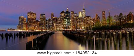 New York City Manhattan Skyline With Skyscrapers Over Hudson River Illuminated Lights At Dusk After