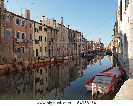 Chioggia, Italy. Ancient palaces mirrored in a canal.