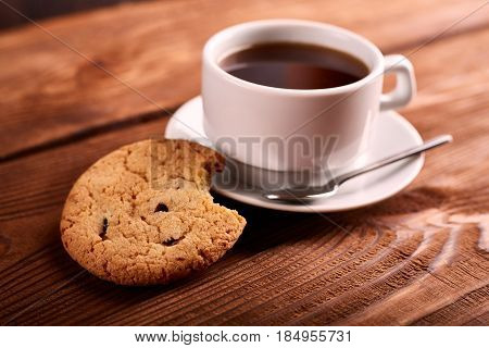 Coffee And Homemade Cookies With Chocolate. Handmade Chocolate Cookies And Cup Of Espresso On Wooden