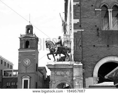 Horse Arcade in Ferrara, Italy. The statue of Duke Niccolò III d'Este. Black and white photos.