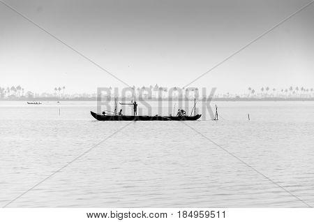 Local fishermen tryinng their luck in Vembanad Lake, Kumarakom, Kerala, India