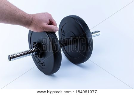 Caucasian Man Hand Grasping An Adjustable Weight Dumbbells Isolated On White Background