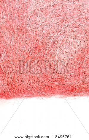 Colored straw. Colored hay. Decorative hay. Wooden wool. Dry colored grass.