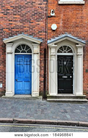 Old ornate wooden doors in Birmingham UK. West Midlands England. poster