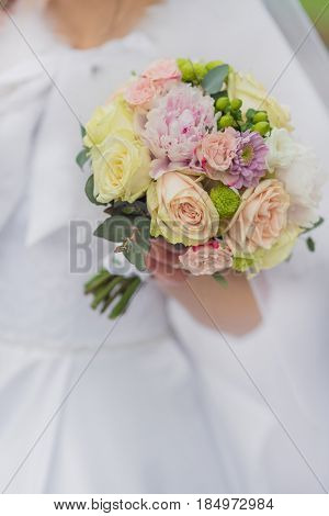 Bouquet in the hands of bride.