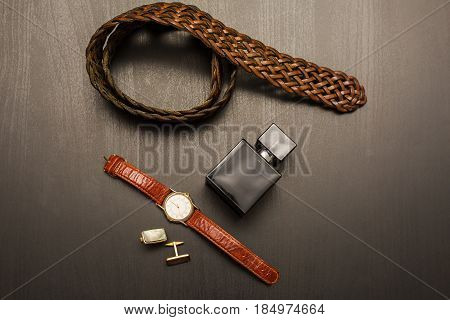 Male accessories . Perfume with belt and cuff