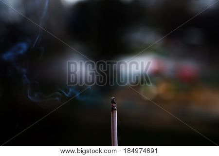 closeup smoking cigarette in a woman's hand