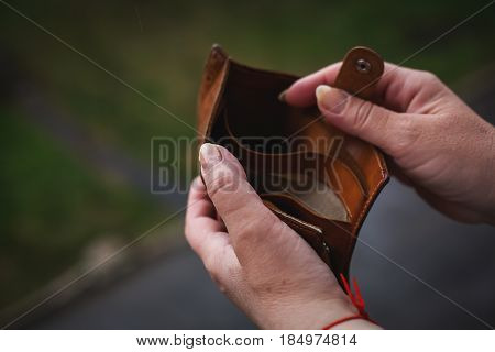 Empty wallet in the hands of woman. Poverty concept