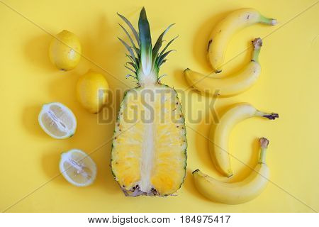 Fruits from above on yellow background, abstract
