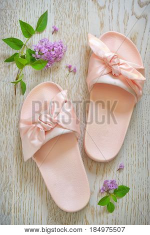 Rose pink woman slippers on wooden background