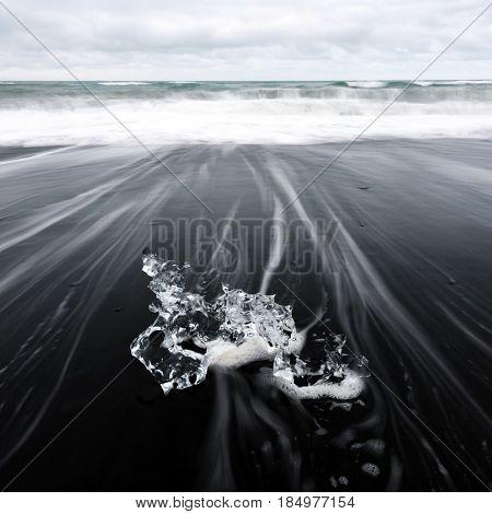 Iceberg piece on Diamond beach, near Jokulsarlon lagoon, Iceland. Minimalist scene