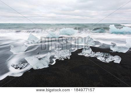 Iceberg pieces on Diamond beach, near Jokulsarlon lagoon, Iceland. Minimalist scene