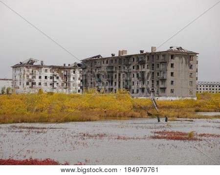 autumn view of abandoned broken buildings in northern russia