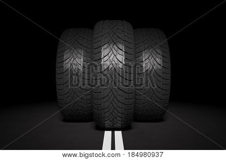 Front view of three tires in the middle of road. Black background. Transportation concept. 3D Rendering