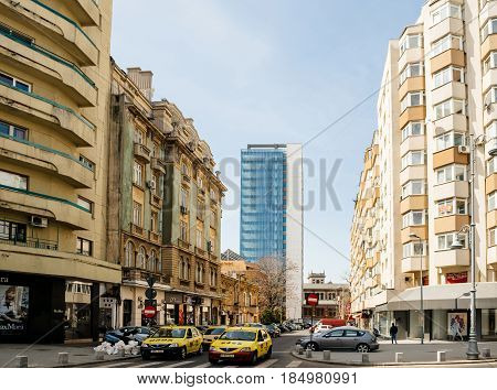BUCHAREST ROMANIA - APR 1 2016: Large view over Bucharest street - Strada General H. M. Berthelot on a sunny day with typical Romanian contrast architecture