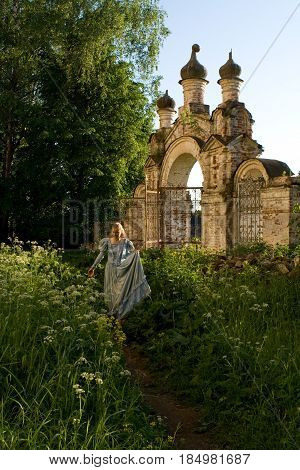The girl is walking along the old abandoned Chernyshev estate. Russia.