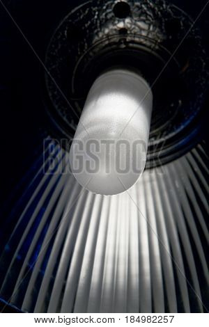 Lamp of a constant light source with a reflector. The photographic equipment is close-up.