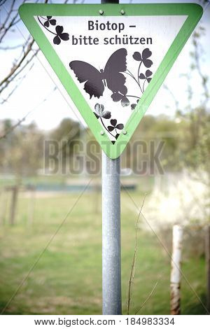 The signpost of a nature reserve with the inscription: biotope caution please protect.