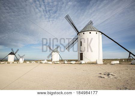white windmills in Campo de Criptana town, province of Ciudad Real, Castilla-La Mancha, Spain