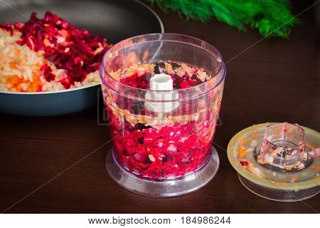 Carrots, Beets And Onions Are Cut For Frying For Borsch In An Electric Chopper. Soup Cooking.