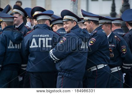 Yoshkar-Ola, Russia - May 4, 2017 General rehearsal of the parade in Yoshkar-Ola. Police officers rest before the march