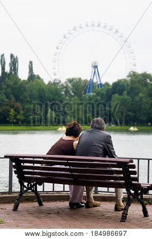 Moscow Russia July 28 2013: Vacationers. A man and a woman at an age are sitting on a park bench.