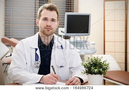 Doctor Gynecologist Working In Office.