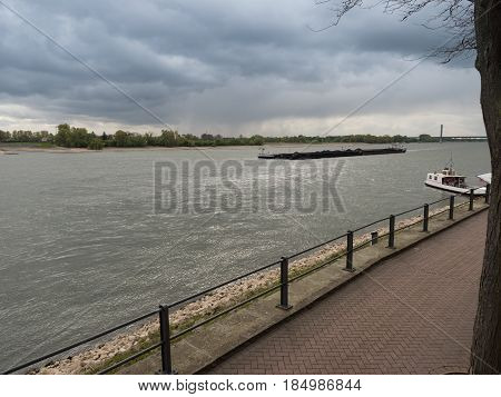 Ship drives the Rhine upstream Rees Germany