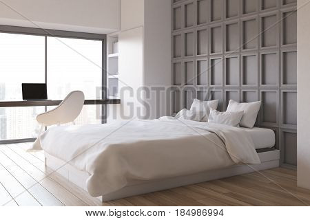 Bedroom interior with a computer table a laptop standing on it and a double bed near a panel wooden wall. Side view. 3d rendering